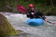 kayaking drysuit and paddler